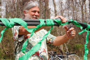 Brotherhug Barlow cuts the inner-tube ribbon on the new Hominy Creek Greenway in 2011. Photo by Kevin Smith
